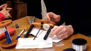 Kevin Hansen demonstrating disassembly of the Woolee Winder flyer for cleaning