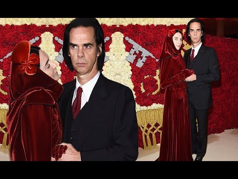 Nick Cave's wife Susie turns heads in a red velvet gown and head piece at the Met Gala