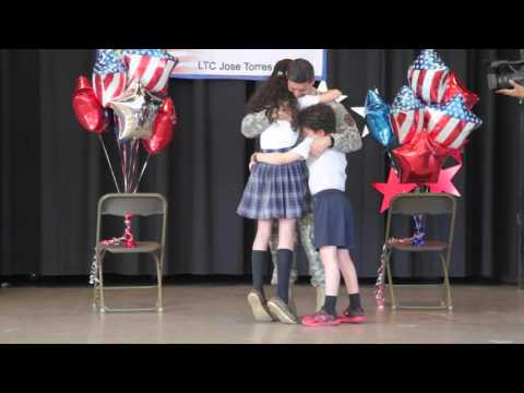 Soldier surprises children after year-long assignment