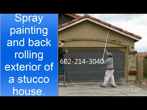 Spray painting and back rolling exterior of the stucco - Painting a stucco house exterior ...