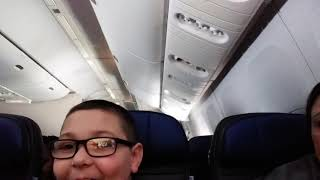 Opening Pokemon cards on a plane