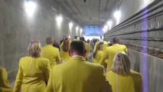 Green bay packers ambassadors approaching Lambeau field through the tunnel