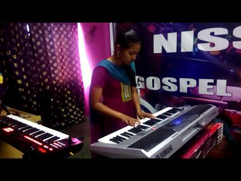 LEARNING keyboard AT NISSI MUSIC ACADMEY