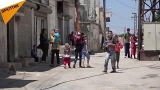 بالفيديو: هكذا عادت الحياة لأحد أحياء حمص بعد رحيل الإرهاب
