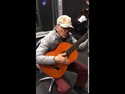Old man plays the mashup of themes from