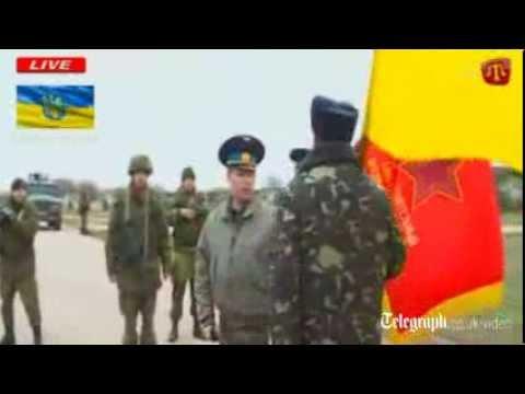 Pro-Russian soldiers fire warning shots as Ukrainians advance on Crimea airbase