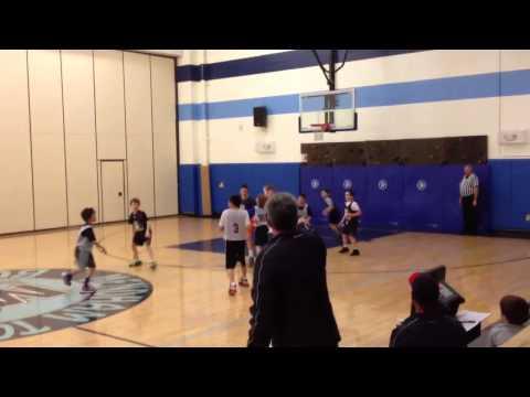 Zach playing basketball