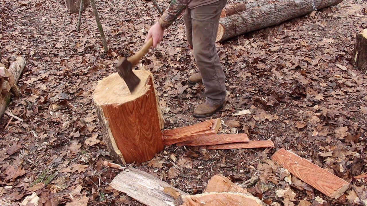 Splitting big wood rounds with an ax youtube