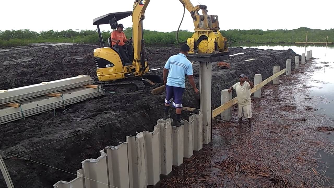 Driving Vinyl Sheet Piling In Belize Youtube