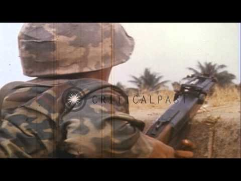 South Vietnamese ARVN (Army of Republic of Vietnam) soldiers attack huts on outsk...HD Stock Footage