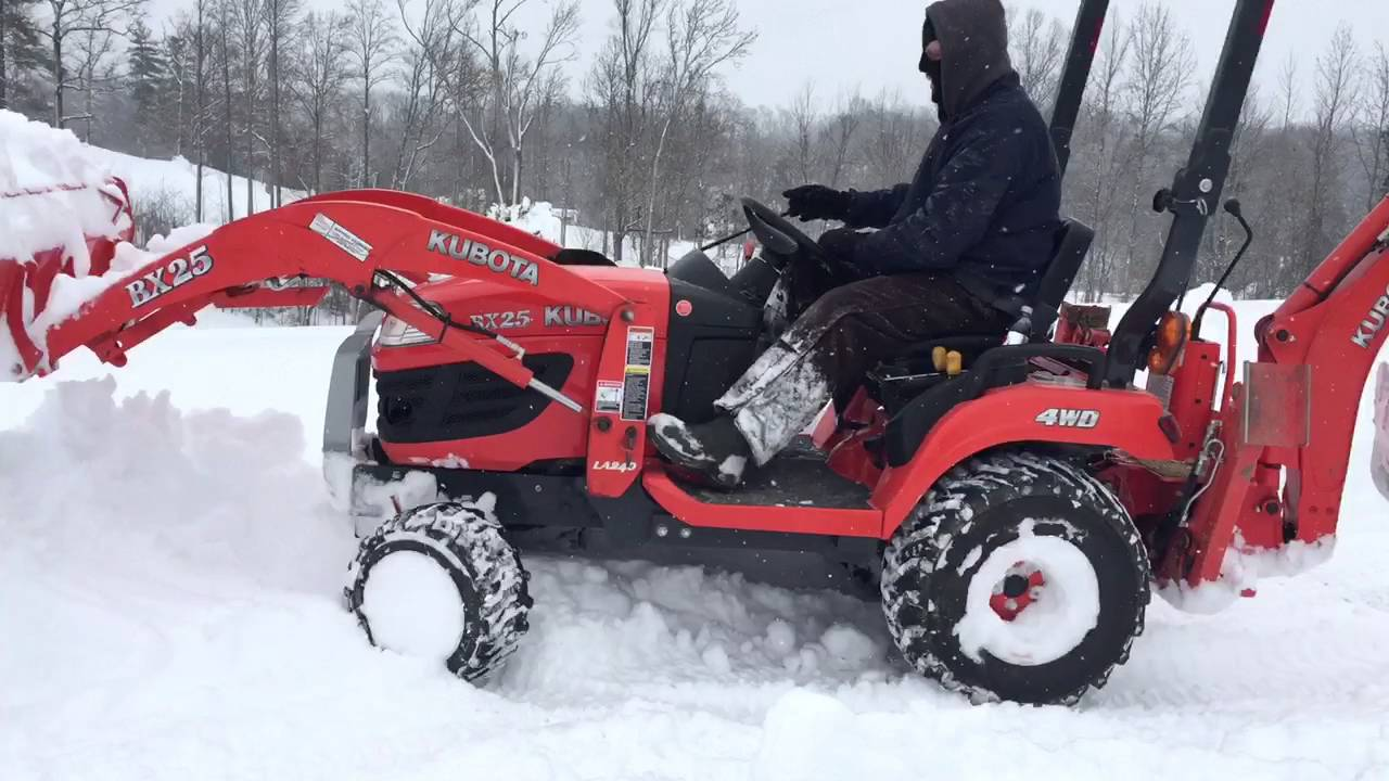 Tractor Snow Plow >> Compact Kubota Tractor plowing nearly 2 feet of snow - YouTube