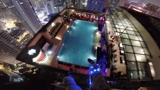 Basejumpers Crashing Rooftop Pool Party - KL Tower 2014