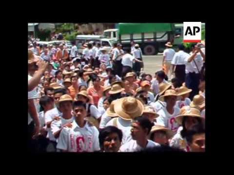 WRAP Protesters demand junta release Suu Kyi, barricades near her home