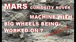 MARS CURIOSITY ROVER MACHINE WITH BIG WHEELS BEING WORKED ON
