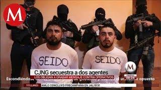 Reaparecen en un video dos policías 'levantados'