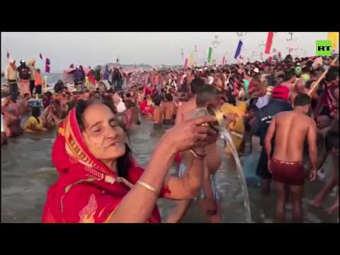 Millions of Hindu worshippers take a dip in the Ganges River to 'wash their past sins'