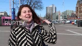 Netherlands: Amsterdam Tourists React To Coronavirus Lockdown