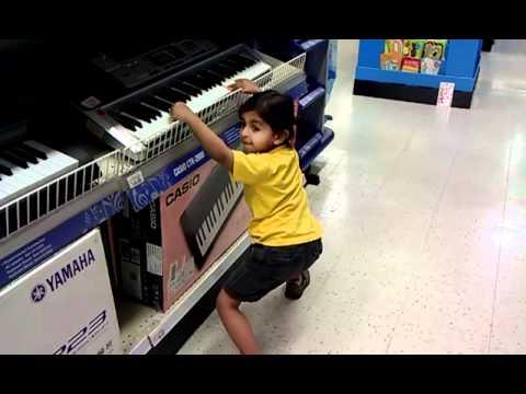 Taran playing the piano at Toys R Us