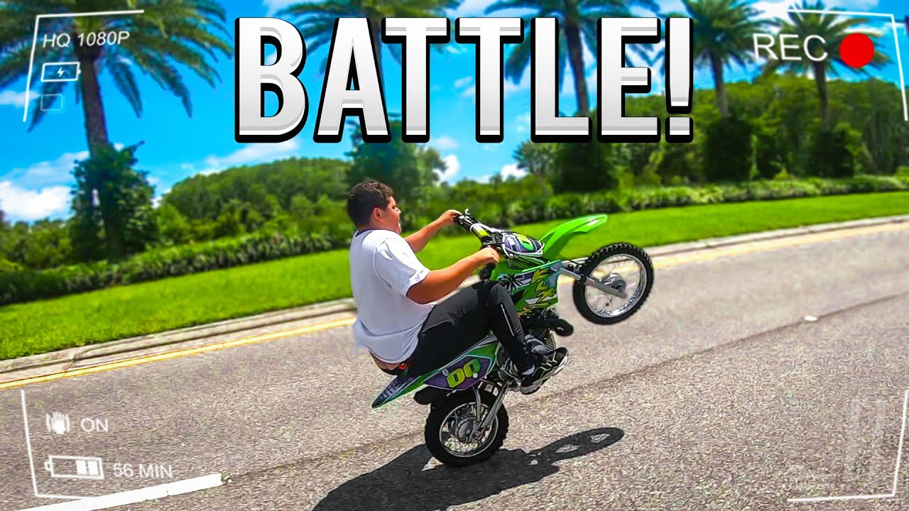 LITTLE BROTHER CALLS ME OUT IN A STREET WHEELIE BATTLE !   BRAAP VLOGS