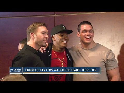 Broncos players watch the draft together