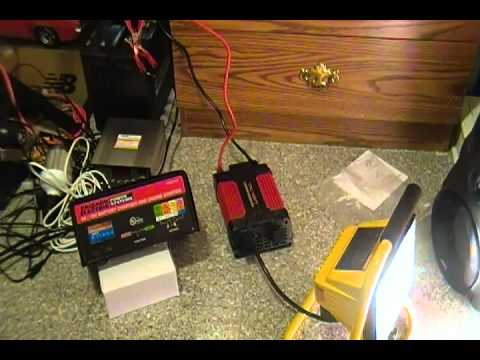 12v Power Inverter Connected To A Battery Charger Running