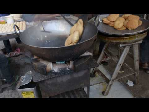 Cooking Bedmi Puri in an Indian food shop