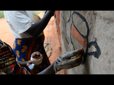 Painted huts offer DR Congo village a tourism lifeline