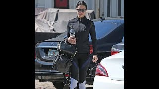 Adriana Lima leaves gym in str iped leggings