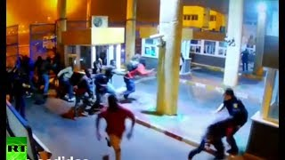 RAW: 100+ migrants breach Spain-Morocco border, guard breaks leg attempting to stop them