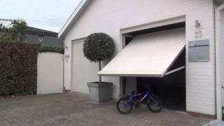 Buiten de gevel draaiende garagepoort