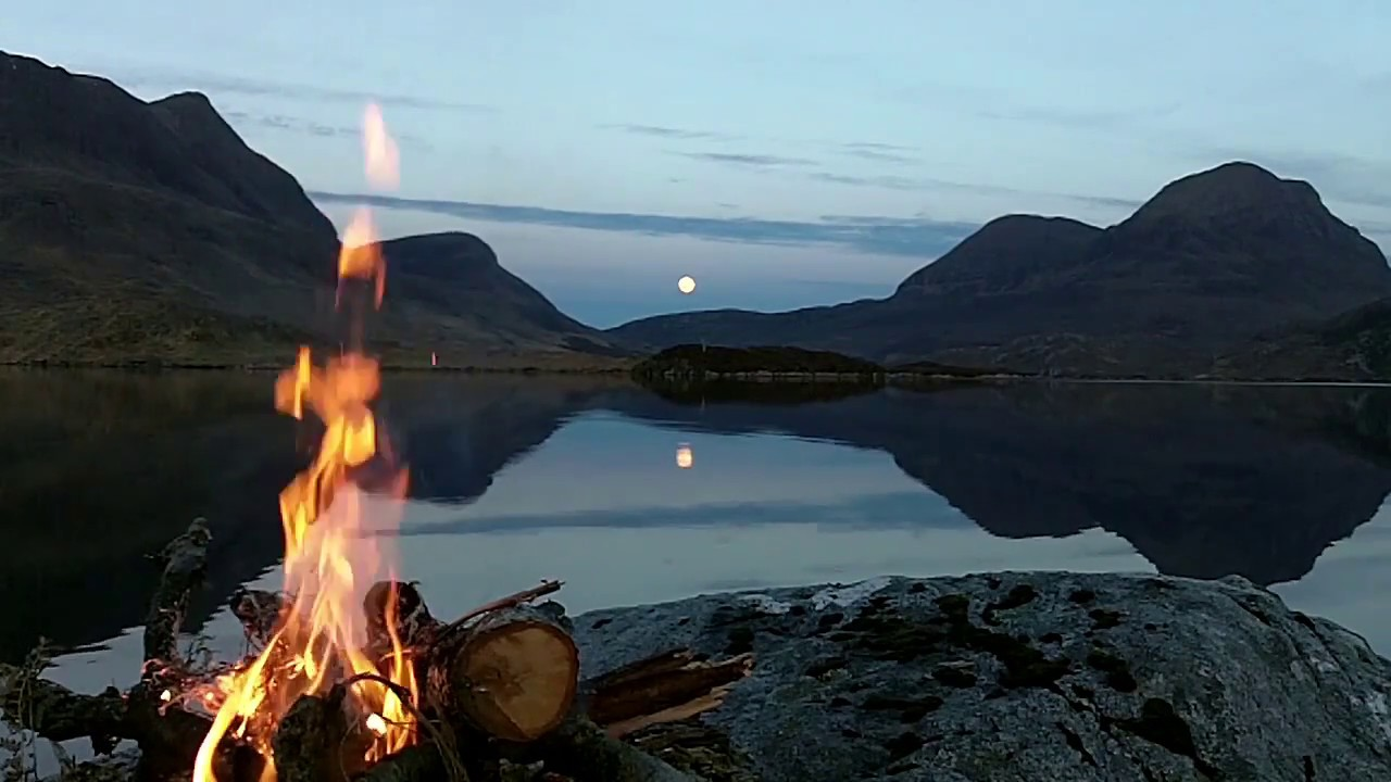 Real Lakeside Wild Campfire (no loop) with full moon rising and crackling logs, Scottish Highlands.