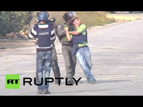 Israeli police run over Palestinian protester, manhandle reporter in Ramallah