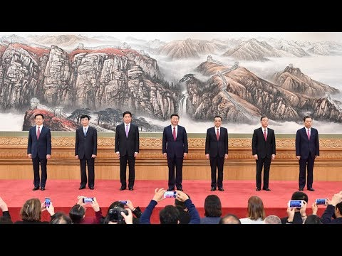 Xi introduces six other newly elected members of the Standing Committee of the Political Bureau
