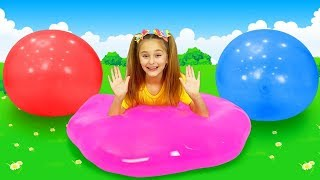 Sasha and Max play with large balloons and a bathtub full of orbeez