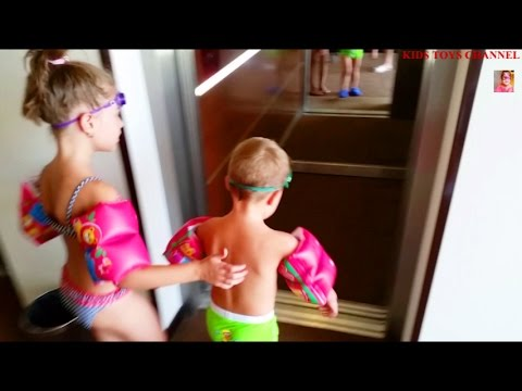 Kids playing in water. Ride at the hotel pool . Funny video 2015 from KIDS TOYS CHANNEL