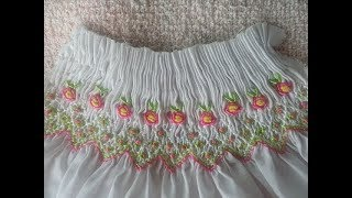 Smocking embroidery with Roses using Bullion stitch on the chest of a dress