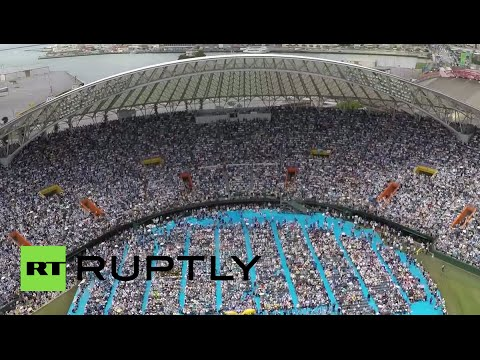 Drone RAW: Stadium packed with protesters against US airbase in Japan