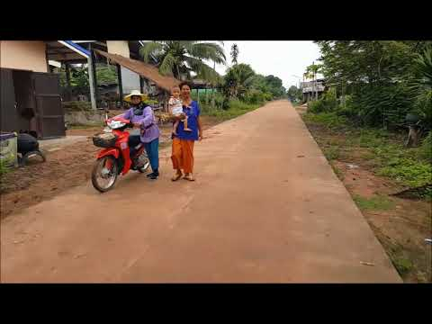 Rural life in Isan, Thailand. Morning ride around the village.