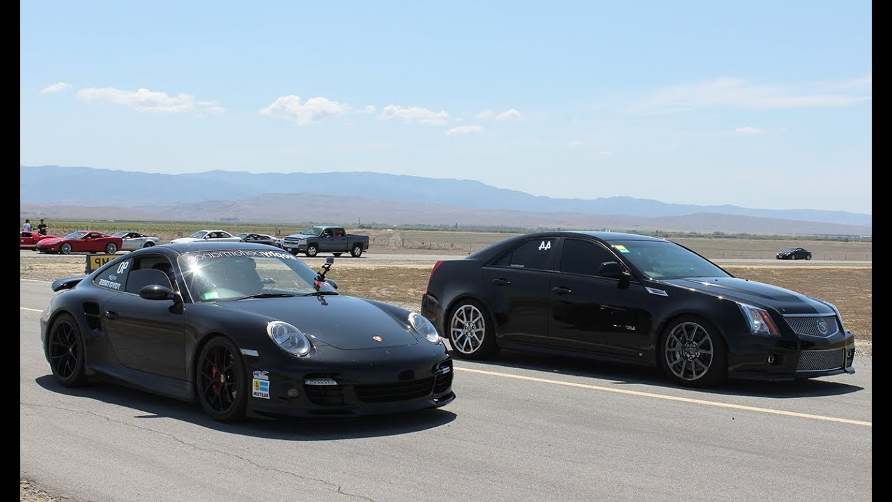 Porsche 911 Turbo Vs Cadillac Cts V Youtube
