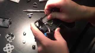 The taking apart and putting back together of the ps4 controller (R2 and L2 toggle spring)