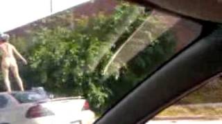 Woman dancing naked on top of car