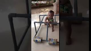 Chinese father created a baby walker with plastic tubes and formula cans.