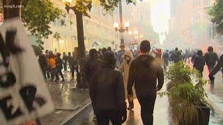 Seattle protesters set fire to SPD cars, break windows in downtown Seattle