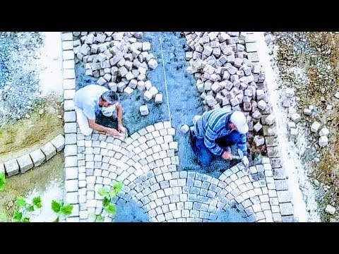 LAYING COBBLES, TRADITIONAL ARC PATTERN, NATURAL CUBE STONES, CARPET TECHNIQUE, GRITSTONE SETTS PRO