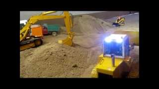 Radio controlled construction equipment moving dirt