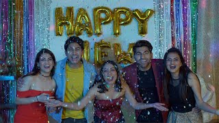 Crazy young friends celebrating New Year's Eve together at a house party in India
