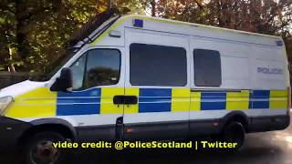 Convoy Of Vehicles Carrying 100 Public Order Officers From Police Scotland Heads To London