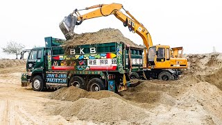 Full loaded ud truck with sand by machines.