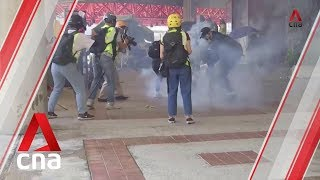 Tear gas fired as Hong Kong police and protesters clash at university