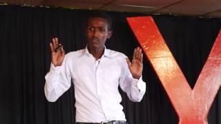 I fled Somalia in a migrant boat to Yemen. This is my story | Sadik Adawe | TEDxMogadishu